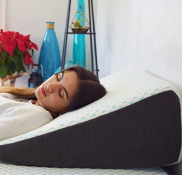 using a wedge pillow helps sleeping