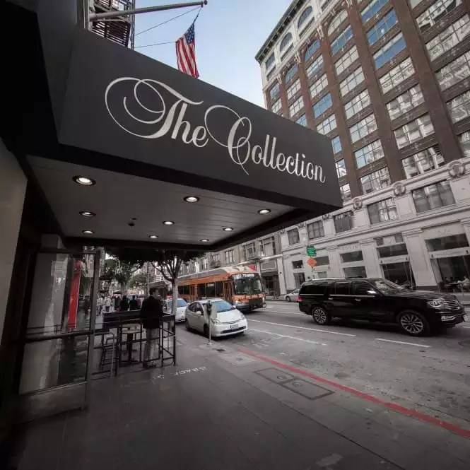 The Outside Signage of Our Building - The Collection