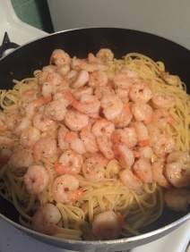 Add cooked shrimp back to pan
