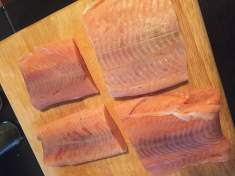 Gather salmon fillets, evenly coat with oil, and salt