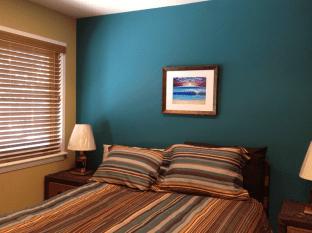 accent wall draws paint color from bedding and art