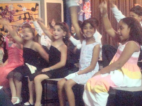 Class 2-119 and Louis Arsmstrong  singing Bob Thiele\'s  It\'s A Wonderful World.