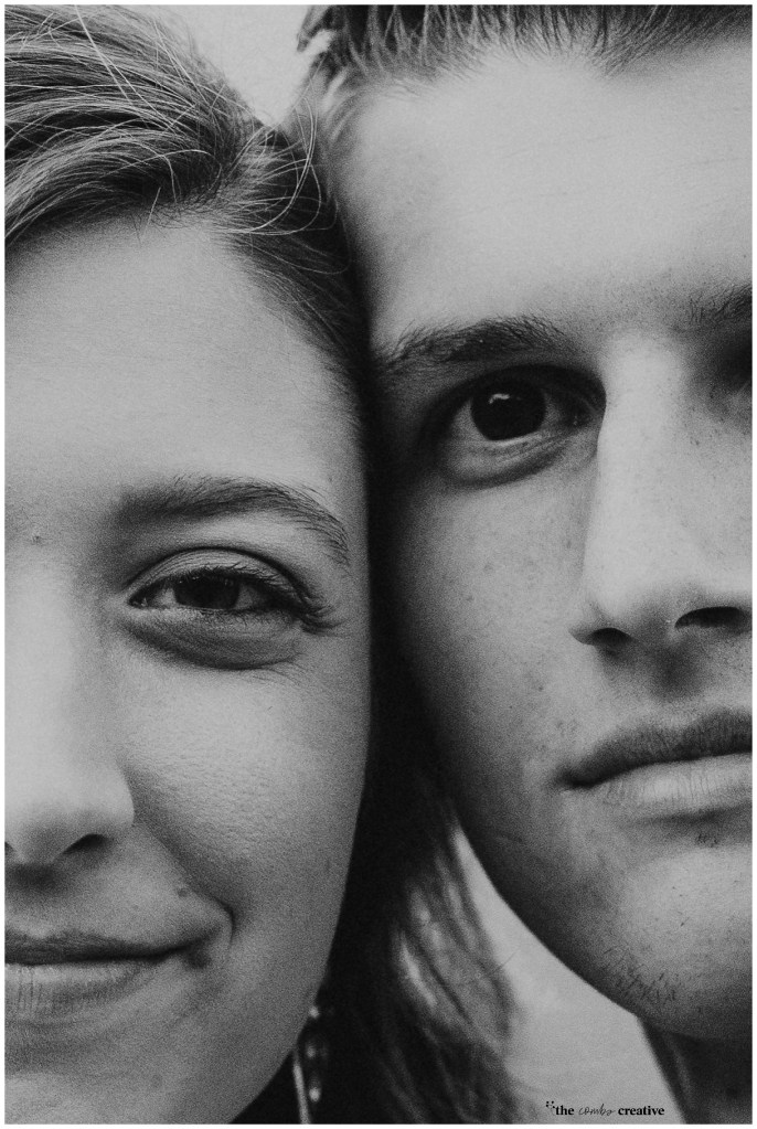 Close up of a newly engaged couple focusing on the emotion in their eyes.