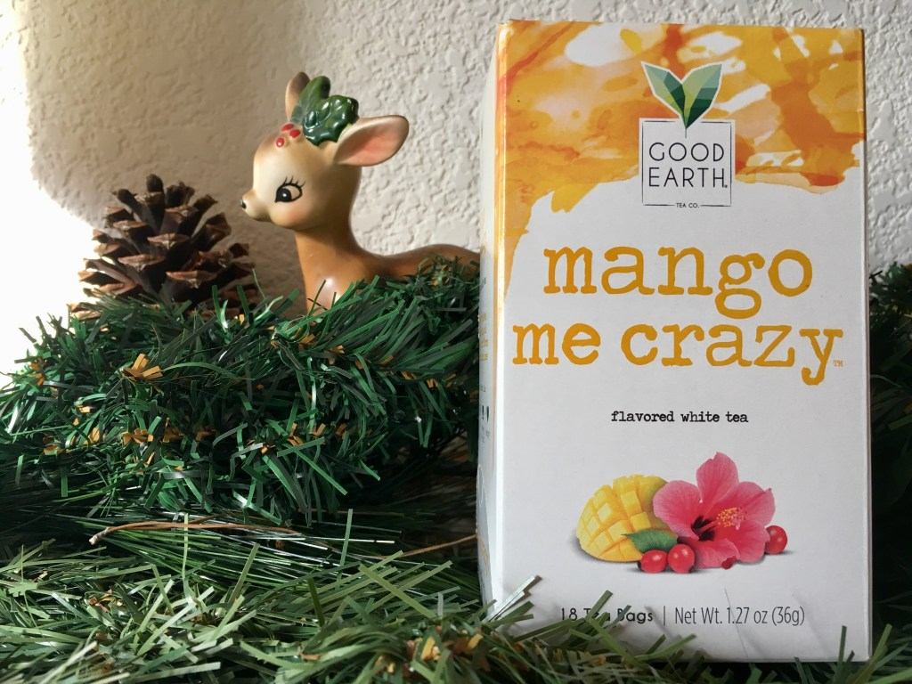 Mango Me Crazy tea box on mantle next to Christmas decorations