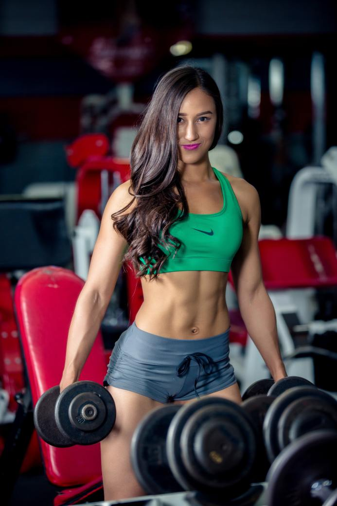 Fit woman holding dumbbells