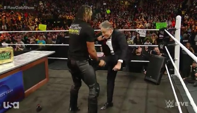 Jon Stewart visits WWE's Monday Night RAW, kicks Seth Rollins in the balls