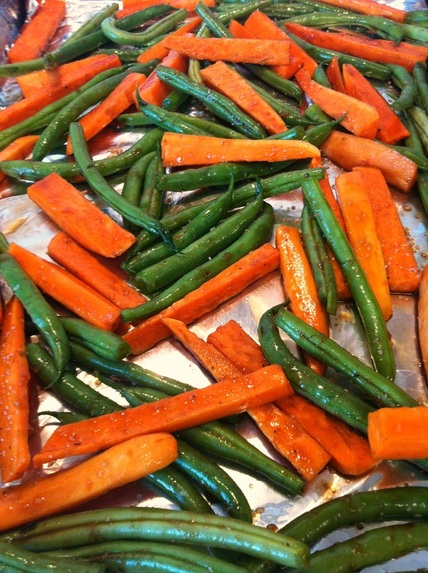 Prepping the veggies Balsamic-Maple Sweet Potatoes and Green Beans - Roasted together and tossed with sweet maple syrup, tangy balsamic vinegar and herbs.