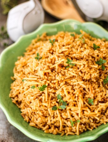 Served rice pilaf garnished with fresh thyme.