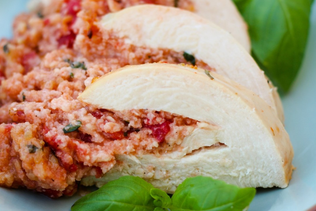 Bruschetta Stuffed Chicken ~ Athick chicken breast envelope slit and stuffed with a bruschetta inspired mixture, topped with a zesty dressing and baked ~ The Complete Savorist by Michelle De La Cerda