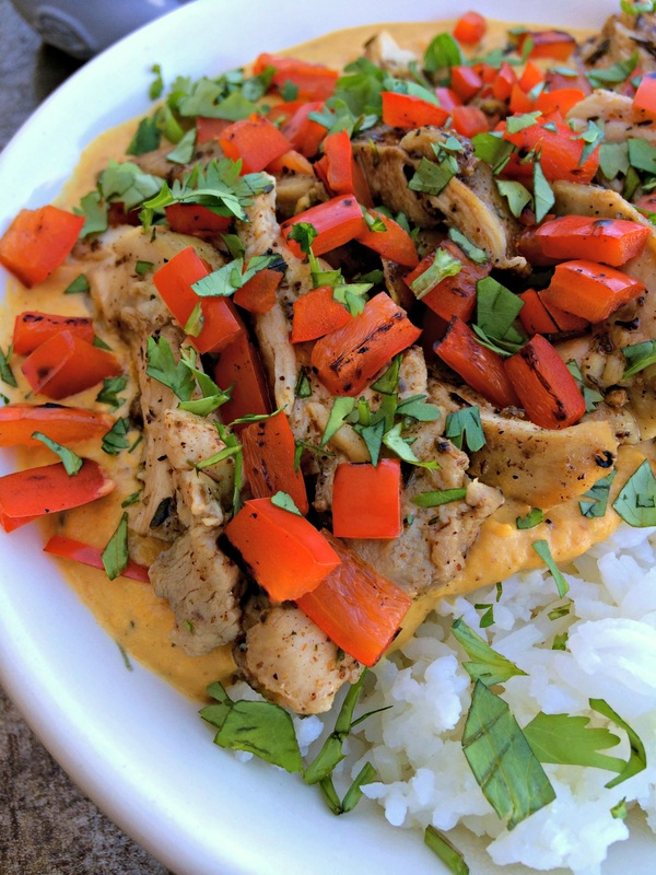 Chicken Pumpkin Curry ~ Pumpkin seasoned with warming spices, herbed chicken, roasted red peppers, and cilantro ~ The Complete Savorist