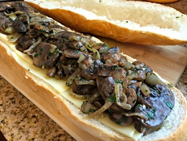Topping with sautéed onions and mushrooms for Mushroom Swiss Cheeseburger Stuffed French Bread ~ The Complete Savorist