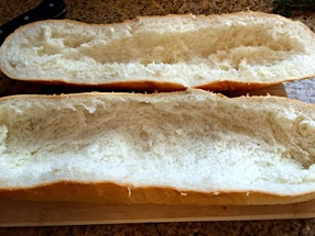 Hallowing out the bread for Mushroom Swiss Cheeseburger Stuffed French Bread ~ The Complete Savorist