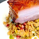Pomegranate-Honey Glazed Pork Belly is a succulent entree with a tangy sweet glaze on a roasted pork belly for a luscious, crowd pleasing meal.~ The Complete Savorist by Michelle De La Cerda