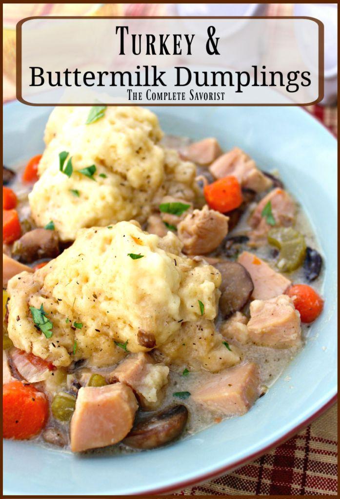 Fluffy buttermilk dumplings with turkey soup in a blue bowl.