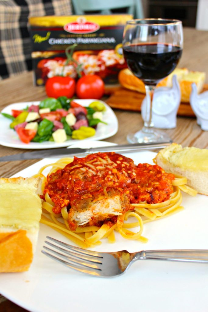 angia-Italian Dinner Night ~ Garlic Cheese bread, a hearty salad, and easy, yet delicious chicken parmesan over linguine make dinner special ~ The Complete Savorist #MangiaTonight ad