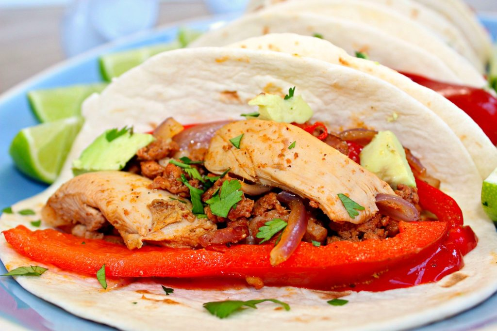 Chicken Alambre ~ Seasoned marinated chicken cooked with fresh chorizo, bacon, onions, peppers, filled in a tortilla and topped with Oaxaca cheese, cilantro, and avocado ~ The Complete Savorist