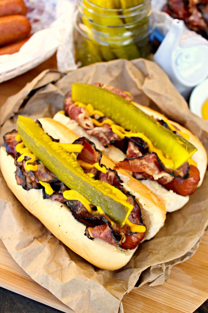 Pastrami Hot Dogs ~ Kosher All-Beef Jumbo hot dogs steam cooked, tossed in a potato bun loaded with New York Style Pastrami, yellow mustard and a dill pickle ~ The Complete Savorist