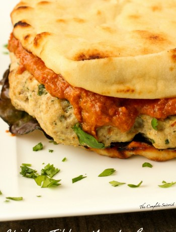 Chicken Tikka Masala Burger ~ Seasoned freshly ground chicken grilled and slathered in masala sauce served on toasted mini naan ~ The Complete Savorist