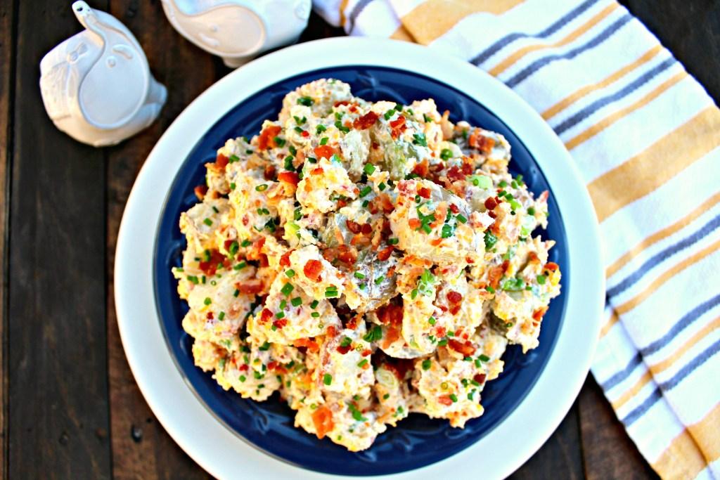 Loaded Bacon Cheddar Baked Potato Salad ~ Potato salad with, bacon, cheddar, chives, in a salad base of sour cream, mayo, and Greek yogurt~ The Complete Savorist