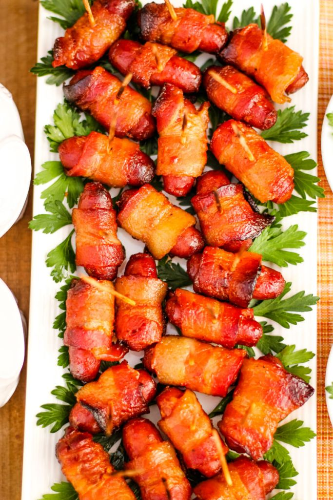 Maple Whiskey Glazed Bacon Wrapped Lit'l Smokies® will be the hit of any gathering with a rich glaze of maple and whiskey then wrapped in bacon ~ The Complete Savorist by Michelle De La Cerda