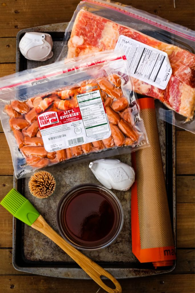 Packages of bacon, mini sausages, and other items for making this recipe.
