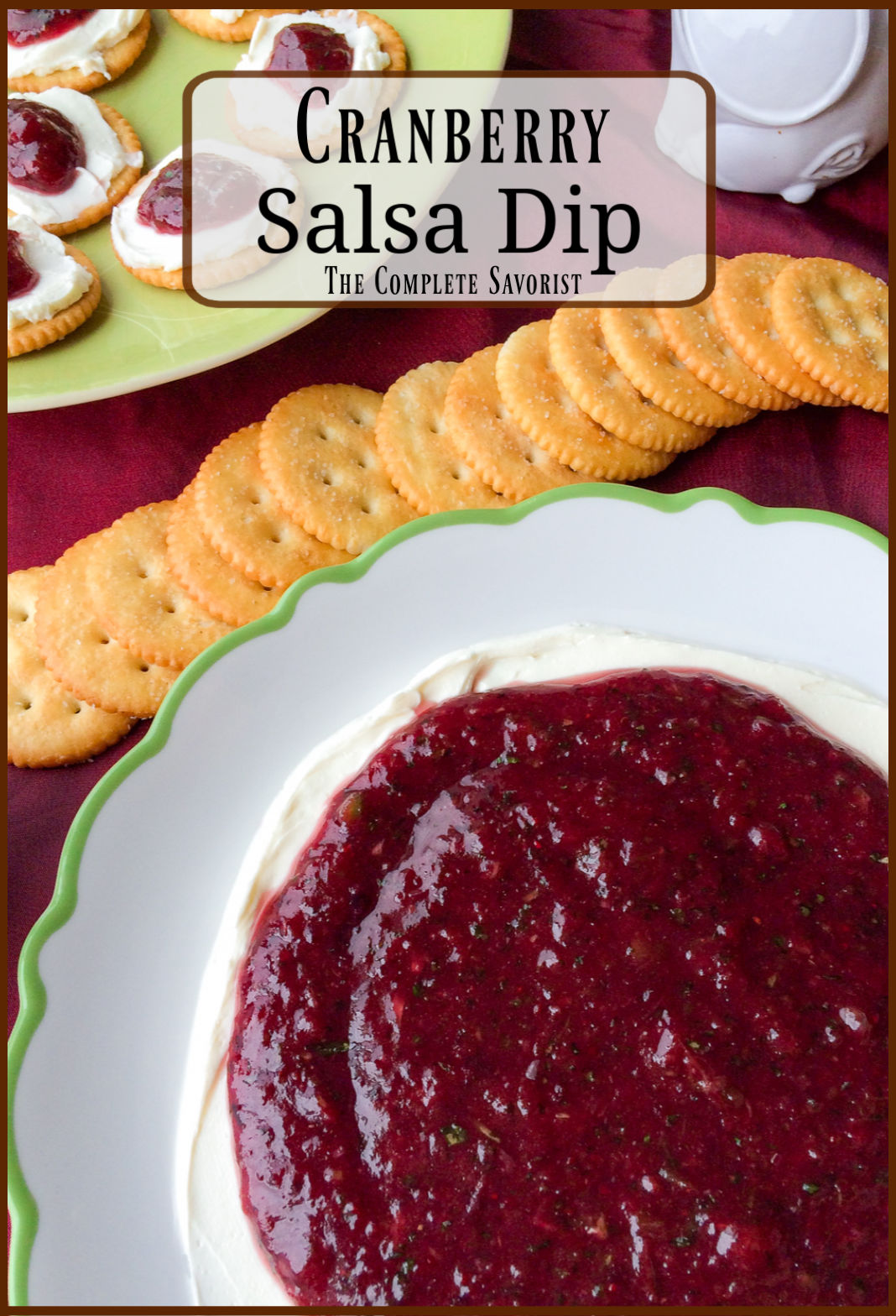 Cranberry salsa over a plate of softened smoothed cream cheese, with butter crackers.