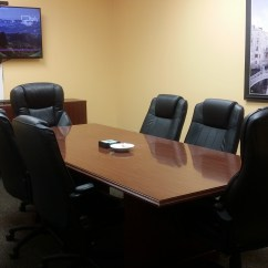 Office Chair Rental Rocking Stainless Steel Meeting Space The Concierge Suites Conference Room With Yellow Walls Wooden And Six Chairs Television