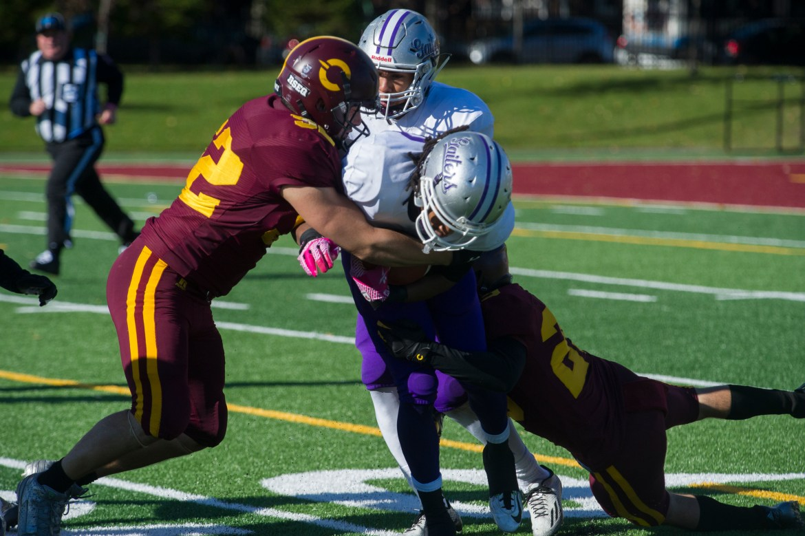 Concordia defenders tackling the Bishop's ball carrier in Saturday afternoons game. Photo by Andrej Ivanov.