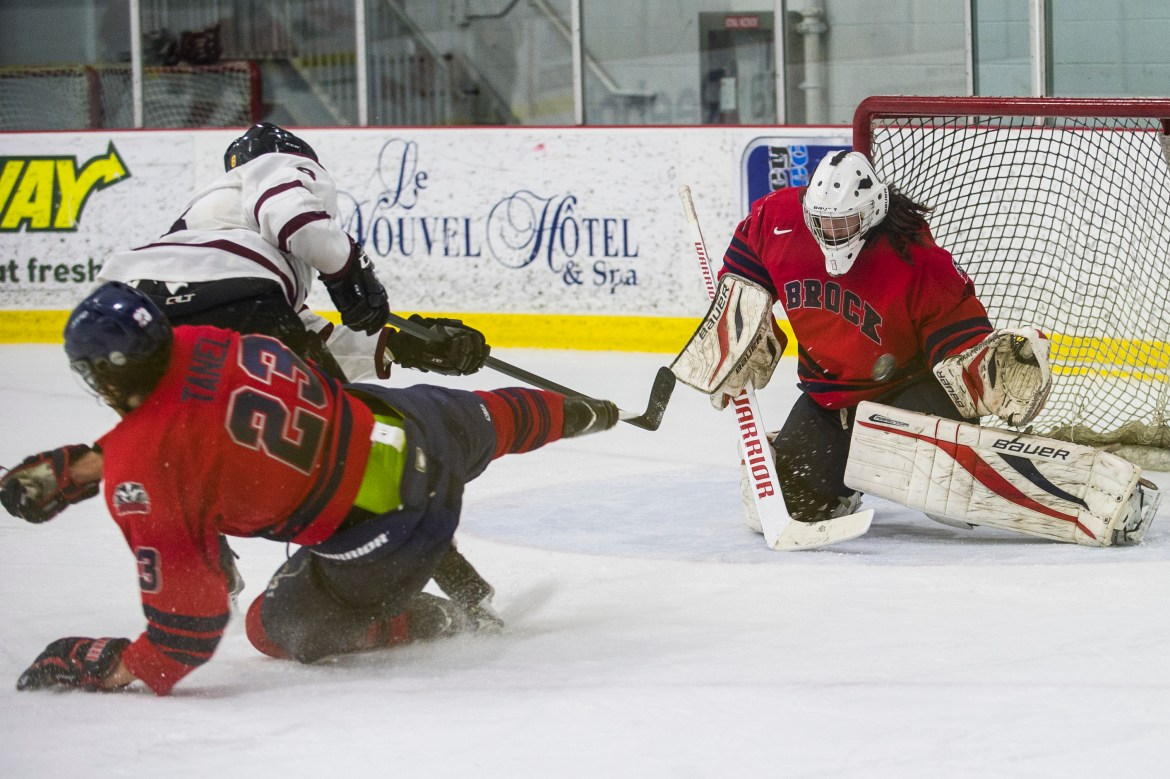 Forward Luca Ciampini scores during the Stingers 7-1 win against the Badgers. Photo by Andrej Ivanov.