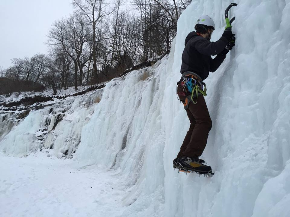 Matthew Packer makes his way up the icy wall. Photo by Mel Allard.