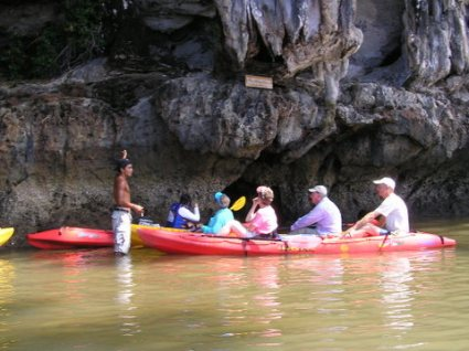 Our guide points out a sea-gypsy cave