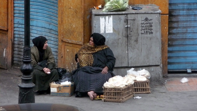 Bread seller across the road from the Grand Hotel on Talat Haab