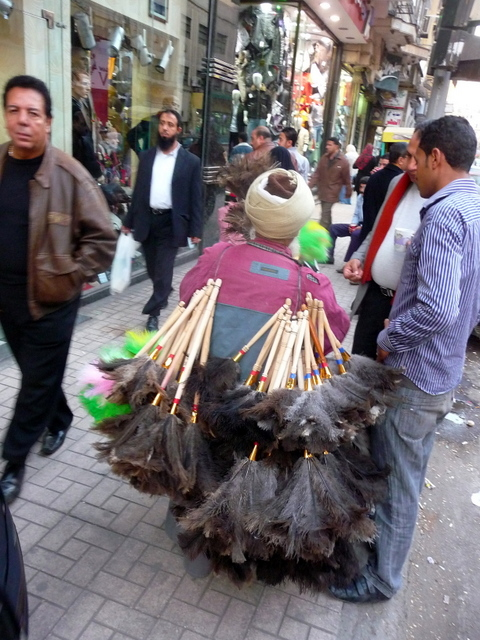 Man selling a much-needed Egyptian bit of kit - the duster