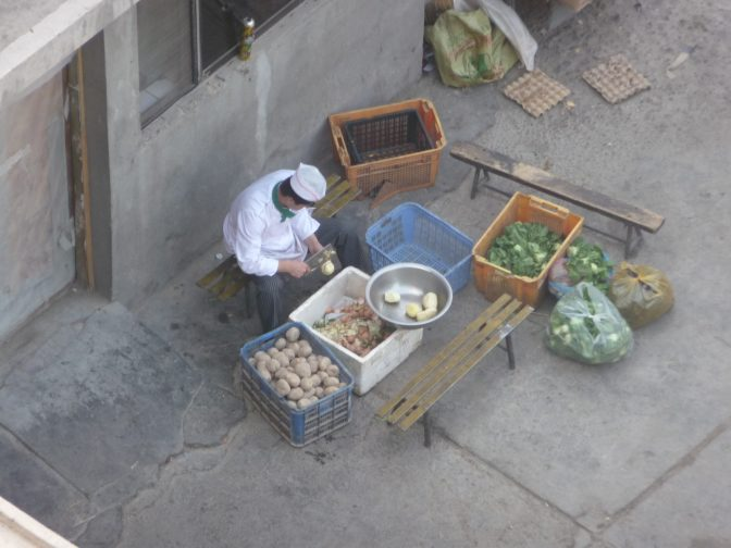 Kitchen prep outside the back of our hotel, seen from my room