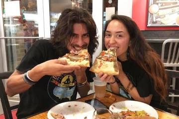 (Look at us enjoying the heck out of this awesome vegan pizza from Ian's in Milwaukee! Thanks to our buddy Roman for treating us!)