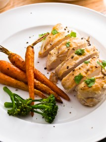 char-grilled chicken breast with roasted carrot,cariander for garnish.