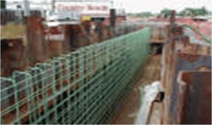 Reinforcement of cantilever retaining wall.