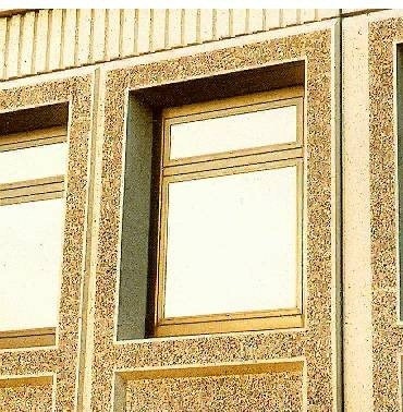 Aggregate faced self finished cladding
