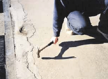 sounding test of concrete by striking with a hammer