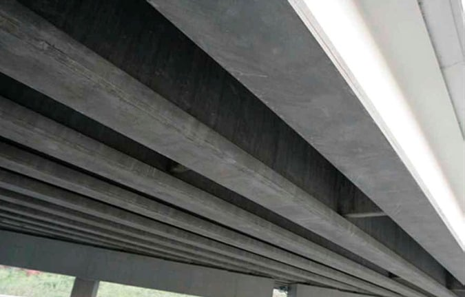 Two Sided FRP Systems for Strengthening of RCC Beams