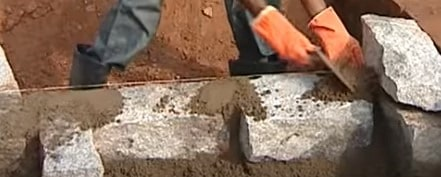 Filling joints between placed stones with mortar