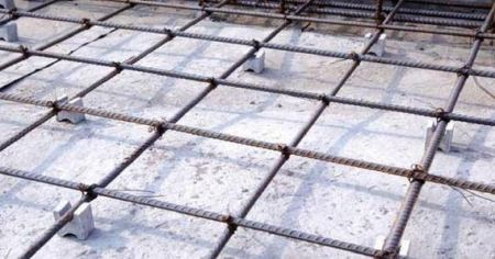 Provision of concrete cover for reinforcement bars in slab