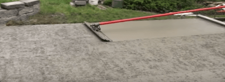 Use of Bull Float to Smooth the Driveway