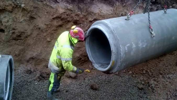 Cleaning Concrete Pipe Bell