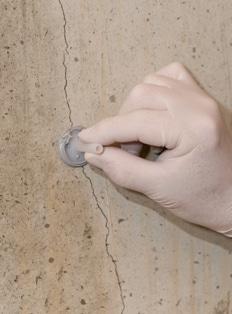 Fixing Ports over Concrete Cracks