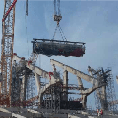 A precast concrete circumferential beam is lifted into place