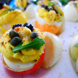 Arugula, Caviar, and Capers Deviled Egg with Paprika, Parmesan and White Truffle Balsamic Glaze