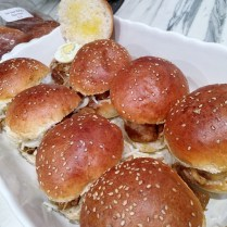 Place top half of buns