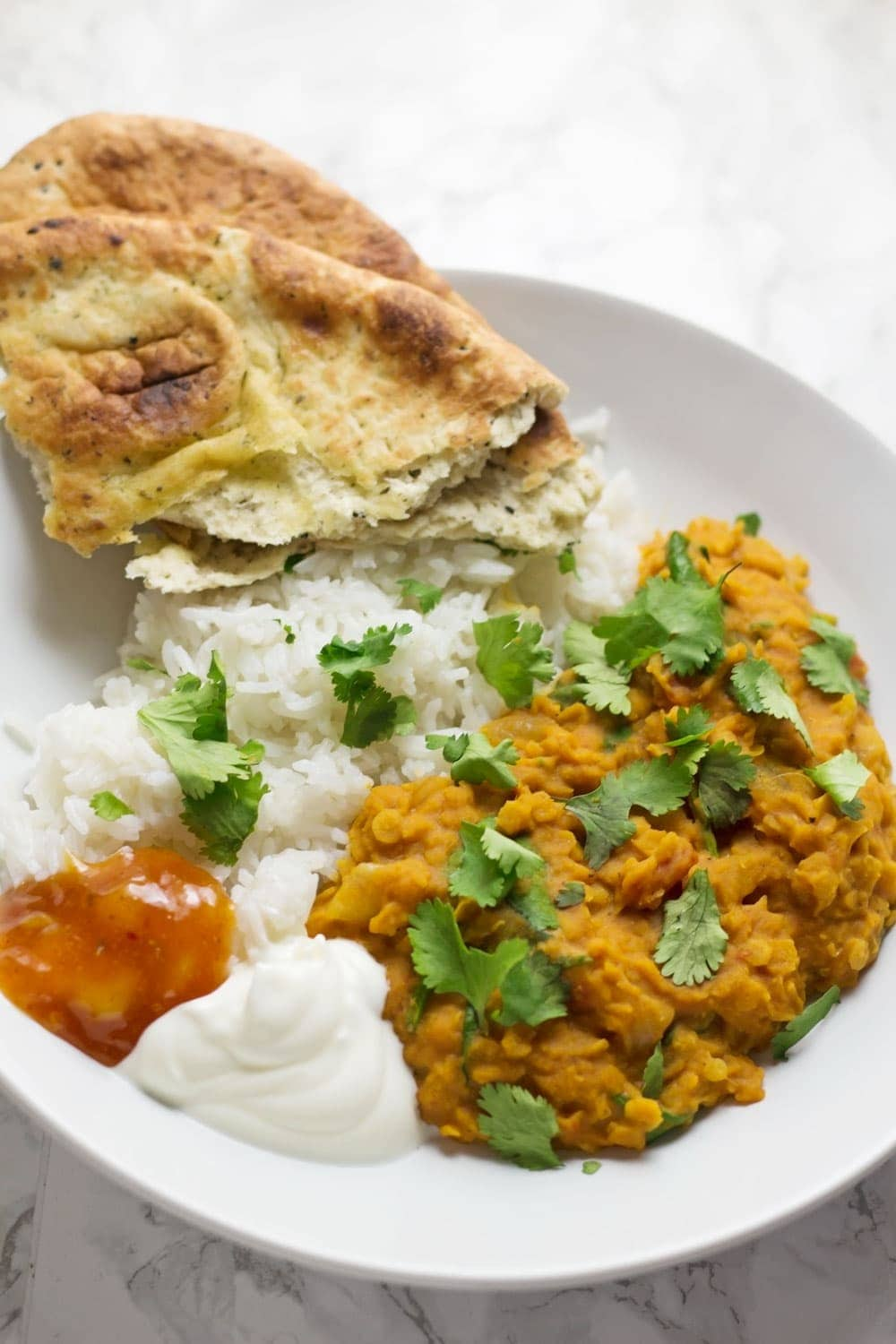 This red lentil dal is perfect when you're craving that curry flavour but you want something quick and healthy.Serve with yoghurt and mango chutney.