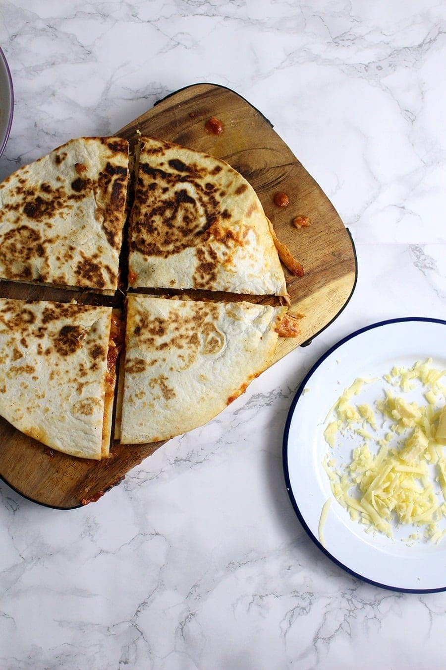 These slow cooker chipotle chicken quesadillas are the perfect weeknight dinner. At the end of the day just shred your chicken and fry up some quesadillas!